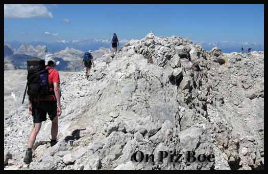 Striding out on Piz Boe, with the central Alps to the north